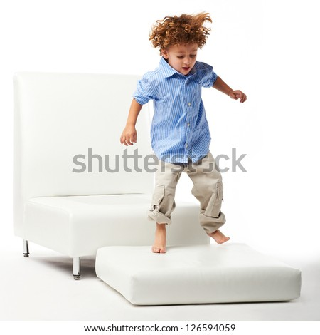 young kid jumping - stock photo