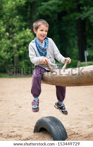 Young kid playing in the park. - stock photo