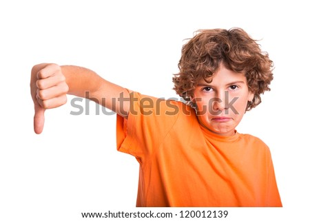 Young kid protesting and showing thumb down - stock photo