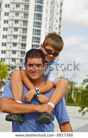 Young Kid, Young Man - stock photo