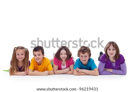 Young kids laying on the floor - childhood friendship - stock photo