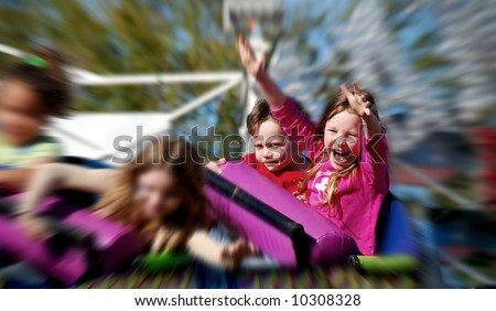 Young Kids on Fast Rollercoaster - stock photo