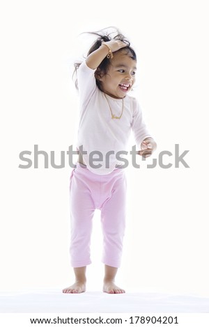 Young kids playing on white background - stock photo