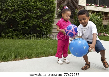 Young kids playing outside - stock photo