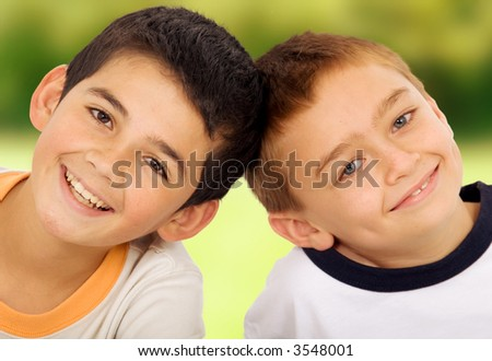 young kids portrait outdoors in a park - stock photo