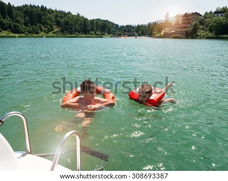 Kids Swimming In A Lake young kids swimming lavarone lake life stock photo 308693387