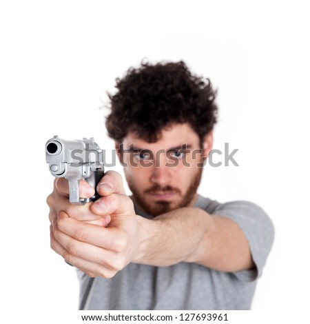 Young killer pointing a gun over white background. - stock photo