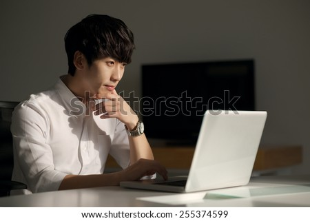 Young Korean businessman working in the office overtime