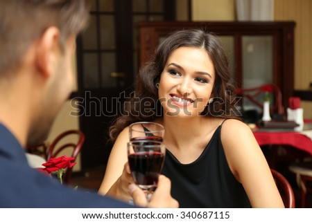 young lady cheers at the restaurant - stock photo