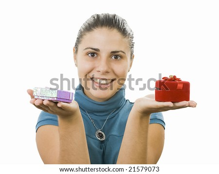 young lady comparing two gifts - stock photo