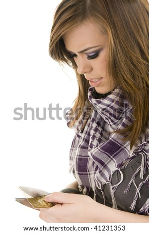 Young lady cutting a credit card - stock photo
