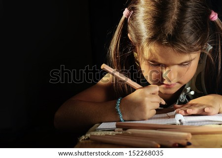 young lady draws a card - stock photo