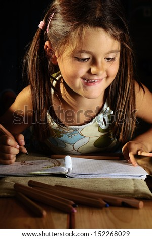 young lady draws a dark classroom - stock photo