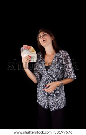 Young Lady fanning herself with various currency notes - stock photo
