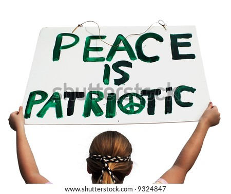 """Young lady holding a """"peace is patriotic"""" sign - isolated. - stock photo"""