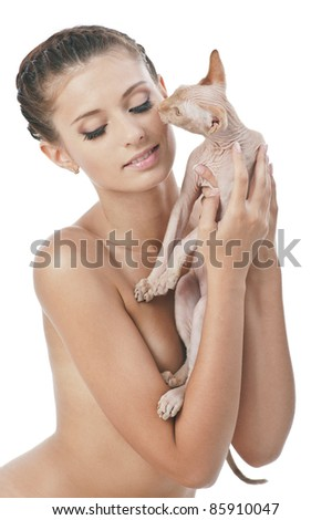 Young lady holding her sphinx cat isolated on white - stock photo