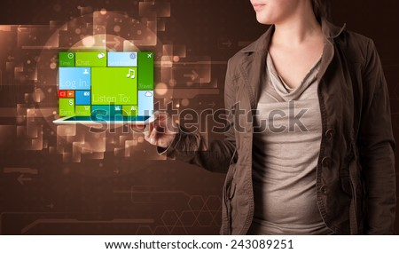 Young lady holding tablet with modern software operational system