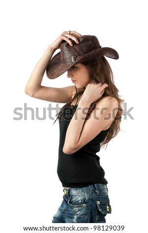 Young lady in a cowboy hat - stock photo