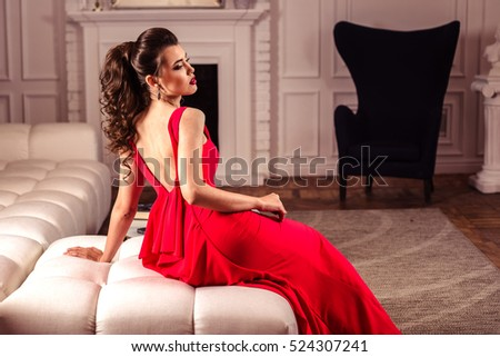 https://thumb7.shutterstock.com/display_pic_with_logo/1532018/524307241/stock-photo-young-lady-in-a-gorgeous-red-evening-dress-in-interior-524307241.jpg