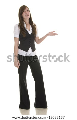 Young lady in black and white business attire on white background, indicating and smiling. - stock photo