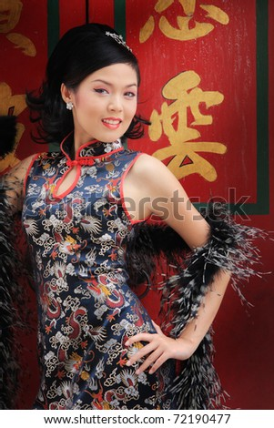 Young lady in black traditional chinese dress , Thailand. - stock photo