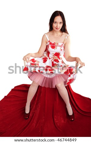 Young lady in color dress sits on the chair