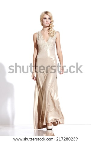 Young lady in fashionable dress posing on white background - stock photo