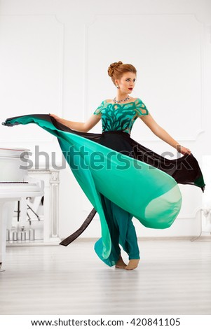 Young  lady in gorgeous dress. Fashion photo - stock photo