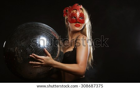 young lady in mask with disco ball - stock photo