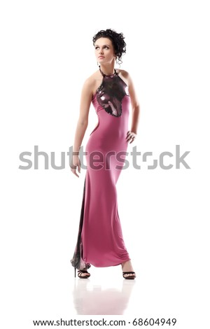 Young lady in pink dress isolated on white background - stock photo
