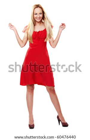 Young lady in red dress dancing on white background - stock photo
