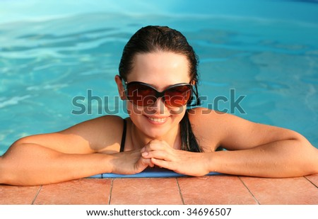Young lady in the swimming pool - stock photo