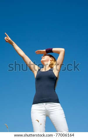 Young Lady is looking far away - stock photo
