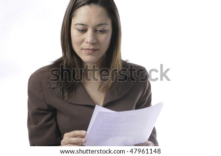 Young lady of filipino ethnicity,is sitting on stool with a white background.She is read a document.It has two pages.Photo is just above the waist. - stock photo