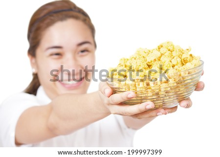 Young lady offering a bowl of popcorn.