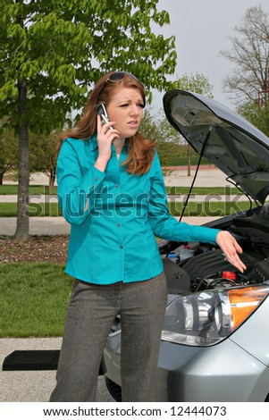 Young Lady on Cellphone with Car Hood Open