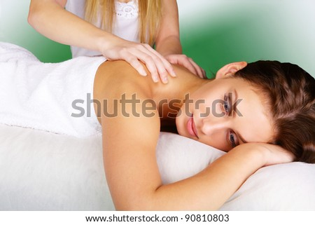 Young lady pampering herself with a relaxing body massage - stock photo