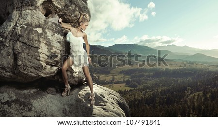 Young lady posing in mountain - stock photo