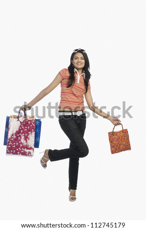 Young lady posing with shopping bags