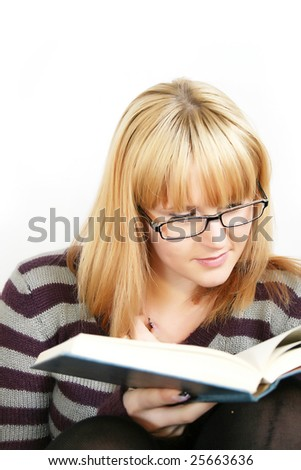 young lady reading a book and with cup in hand