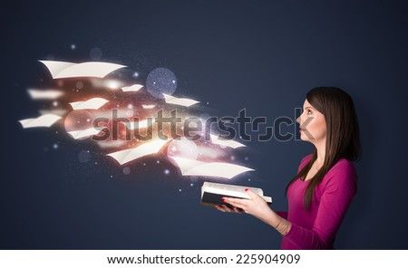 Young lady reading a book with flying sheets coming out of the book, magical reading concept - stock photo