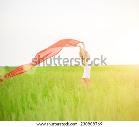 Young lady runing with tissue in green field. Beautiful happy woman walking  in the summer rural meadow. Woman jumping with fabric.Beautiful fit tan girl. Sexy slim model caucasian ethnicity outdoors. - stock photo
