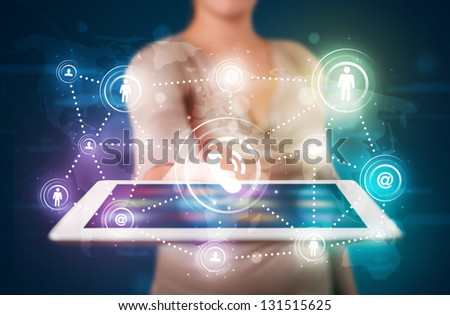 Young lady showing social networking technology with colorful lights - stock photo