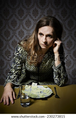 Young lady sitting at a table with all the ideas in front of her, but do not know what she should choose. She is dressed in retro clothes - stock photo