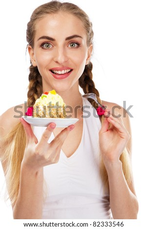 Young lady tasting a cake, studio portrait