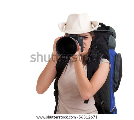 young lady tourist with backpack and digital camera