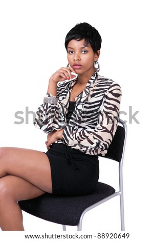 Young lady waiting on a chair with bored expression - stock photo