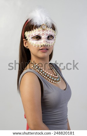 Young lady wearing a mask - stock photo