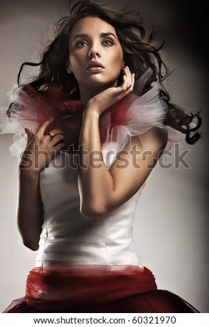 Young lady wearing gorgeous dress - stock photo