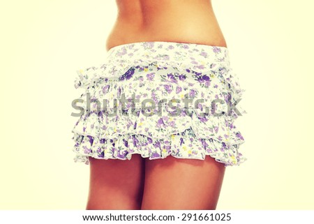 Young lady wearing short skirt - stock photo